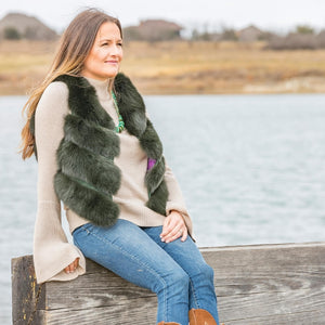 C&B Furs emerald green fox fur vest, beige top