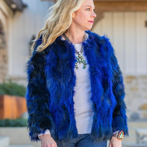 Woman wearing C&B Furs cobalt blue fox fur bolero