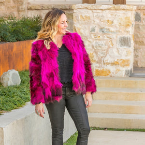 Blonde woman smiling wearing C&B Furs fuchsia fur bolero