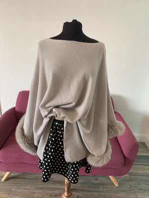 C&B Furs Gray Cashmere Poncho with Fox Fur Trim on Mannequin
