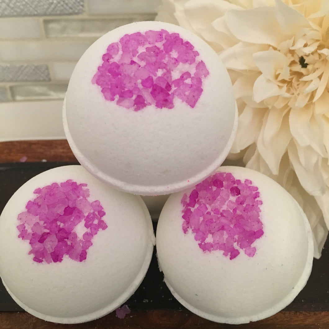 This bath bomb is loaded with Lavender and Chamomile Essential Oils. Lavender is a favorite for nightime baths and treatment for insomnia with its relaxing qualities, and Chamomile had gentile calming properties and reduces tension.