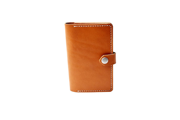 H+B NOTEBOOK/PASSPORT HOLDER | TAN LEATHER