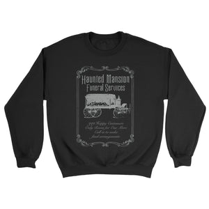 Inspired by Disney's Haunted Mansion the Funeral Services sweatshirt has a victoria style print featuring a hearse. The print is grey and invites you to the Haunted Mansion to make your final arrangements to take up residency in the Haunted Mansion