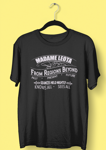 Madame Leota from The Haunted Mansion Tshirt in the style of a victorian medium advertisement. The tshirt is black and the print is a softf pale grey