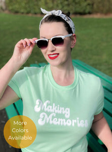 Woman Wearing Mint Green version of Making Memories slogan tshirt