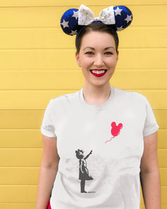 Mouseky Ballon Girl Tshirt small girl wearing mouse ears reaching for a red mickey balloon on a white tshirt