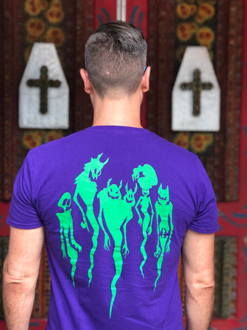 man wearing friends on thr other side printed tshirt showing the back with spirits in green