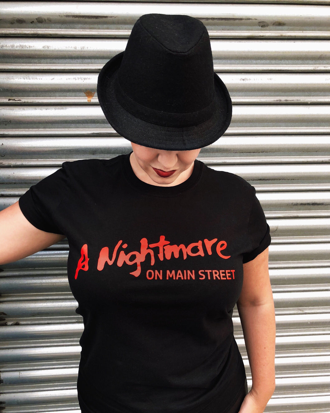A Nightmare on Main Street red logo on bkack tshirt
