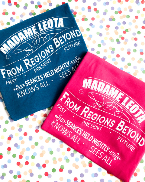 Heliconia Pink and Antique Sapphire Blue Tshirts with a Madam Leota Logo inspired by original victorian seance advertising