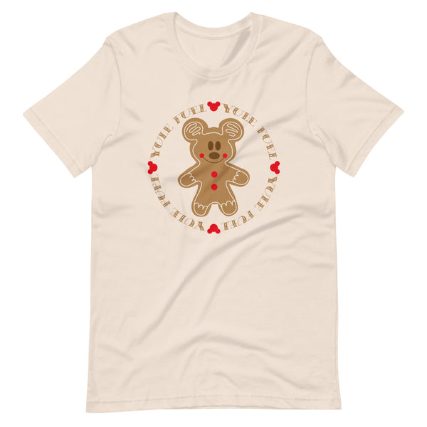 Cream T-Shirt with a Christmas themed print of the chest. In the center is a GIngerbread Mickey with the words Yule Fuel repeated in a circle around him. The circle has little red mickey logos between the words