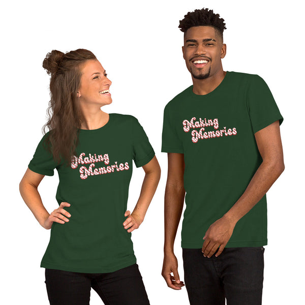Smiling man and women both wearing a dark green tshirt with the retro Making Memories slogan in red ad white candy cane stripes on the chest