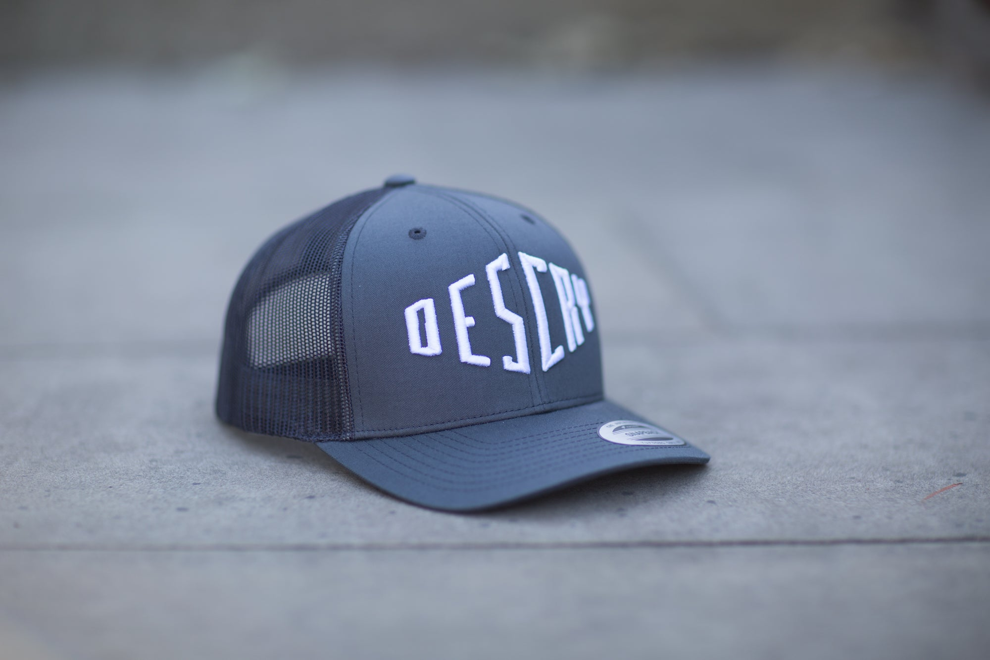 Dark Grey Curved Peak Mesh Trucker