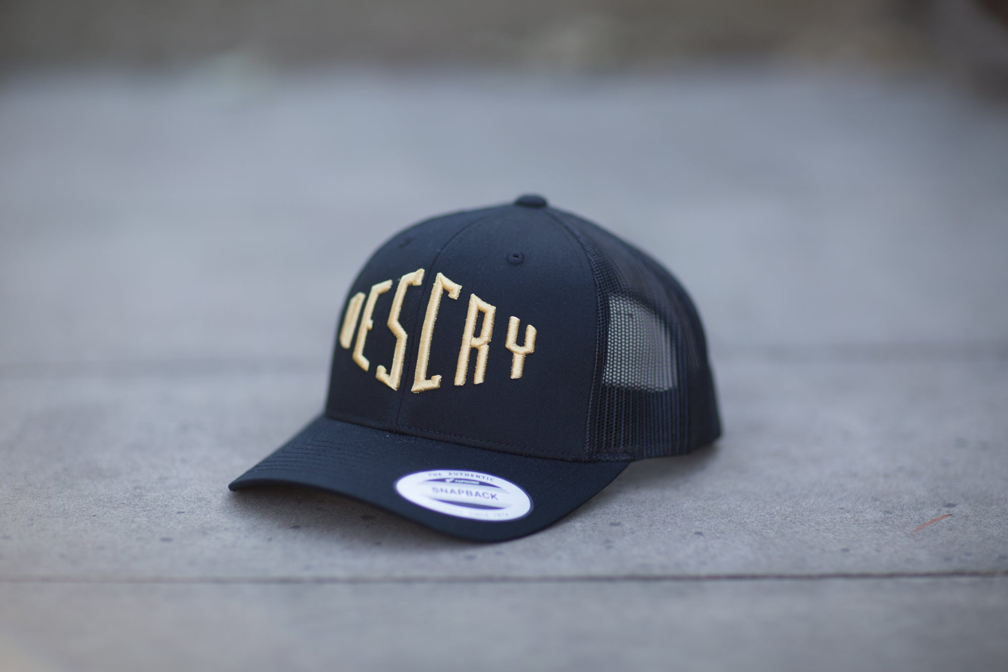 Black/Gold Curved Peak Mesh Trucker