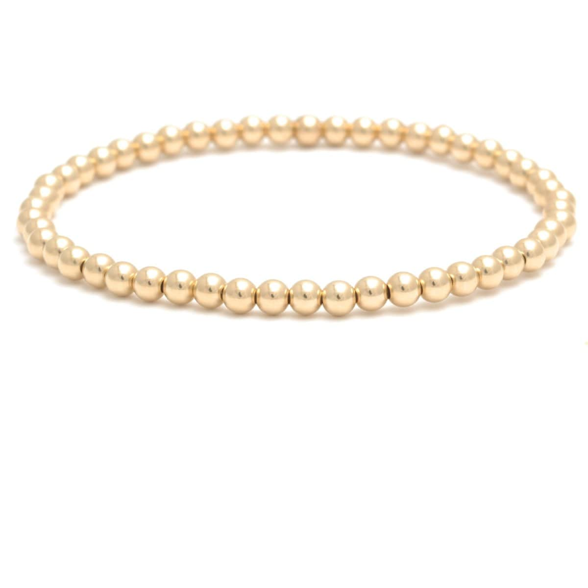 yellow gold round beaded stretchy bracelet
