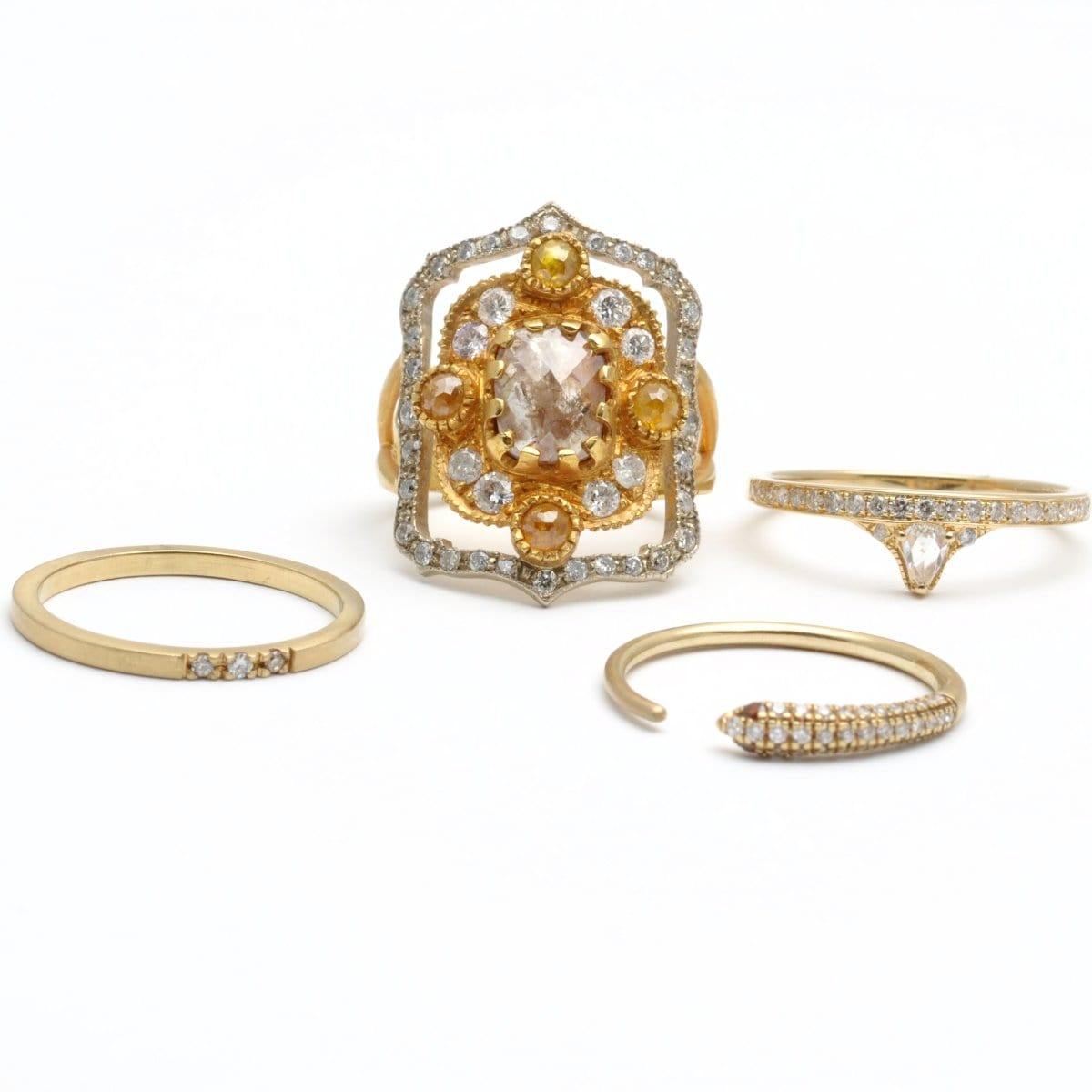 Gold and diamond cocktail ring and stacking rings