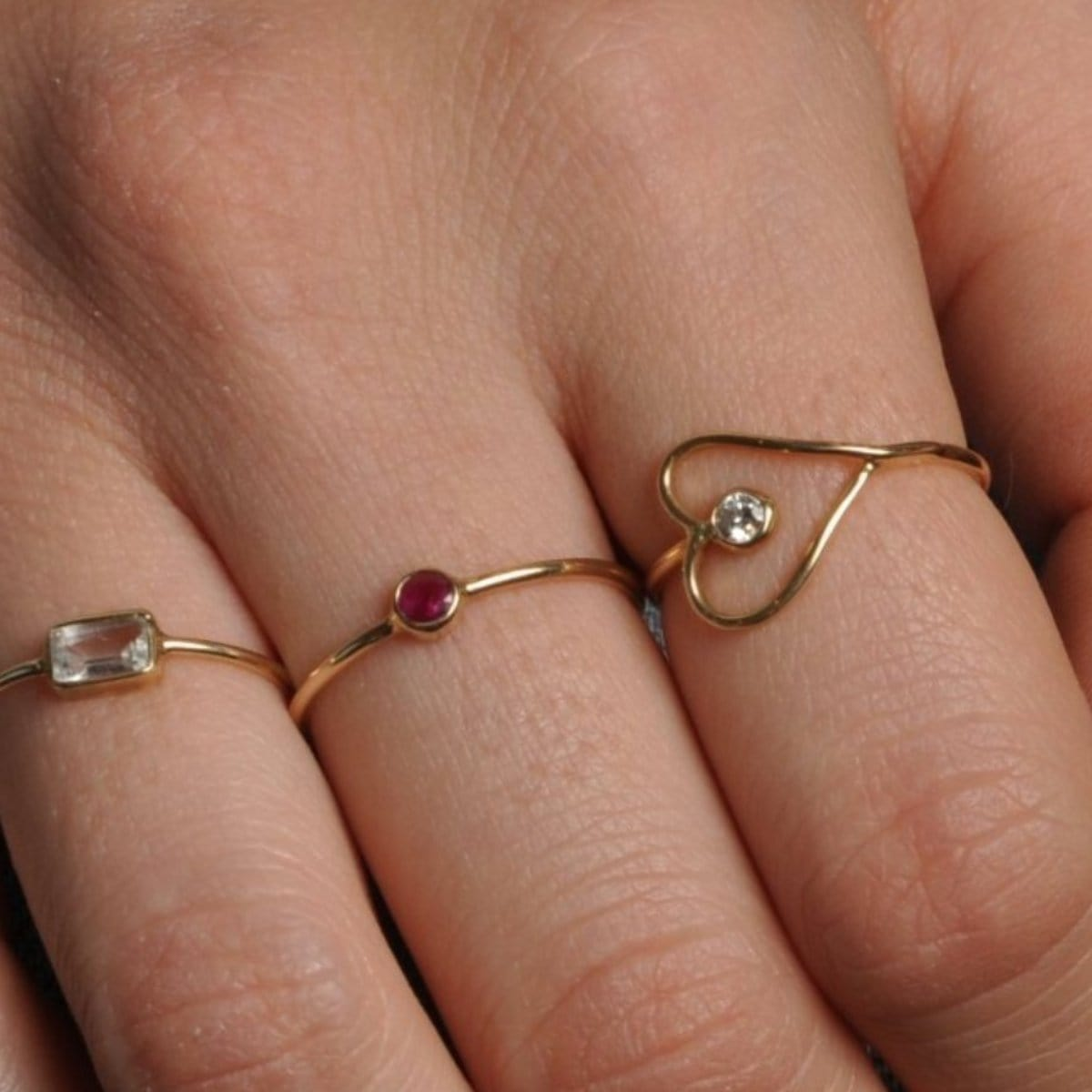Ruby Solitaire Gold Bezel Ring sideways heart ring