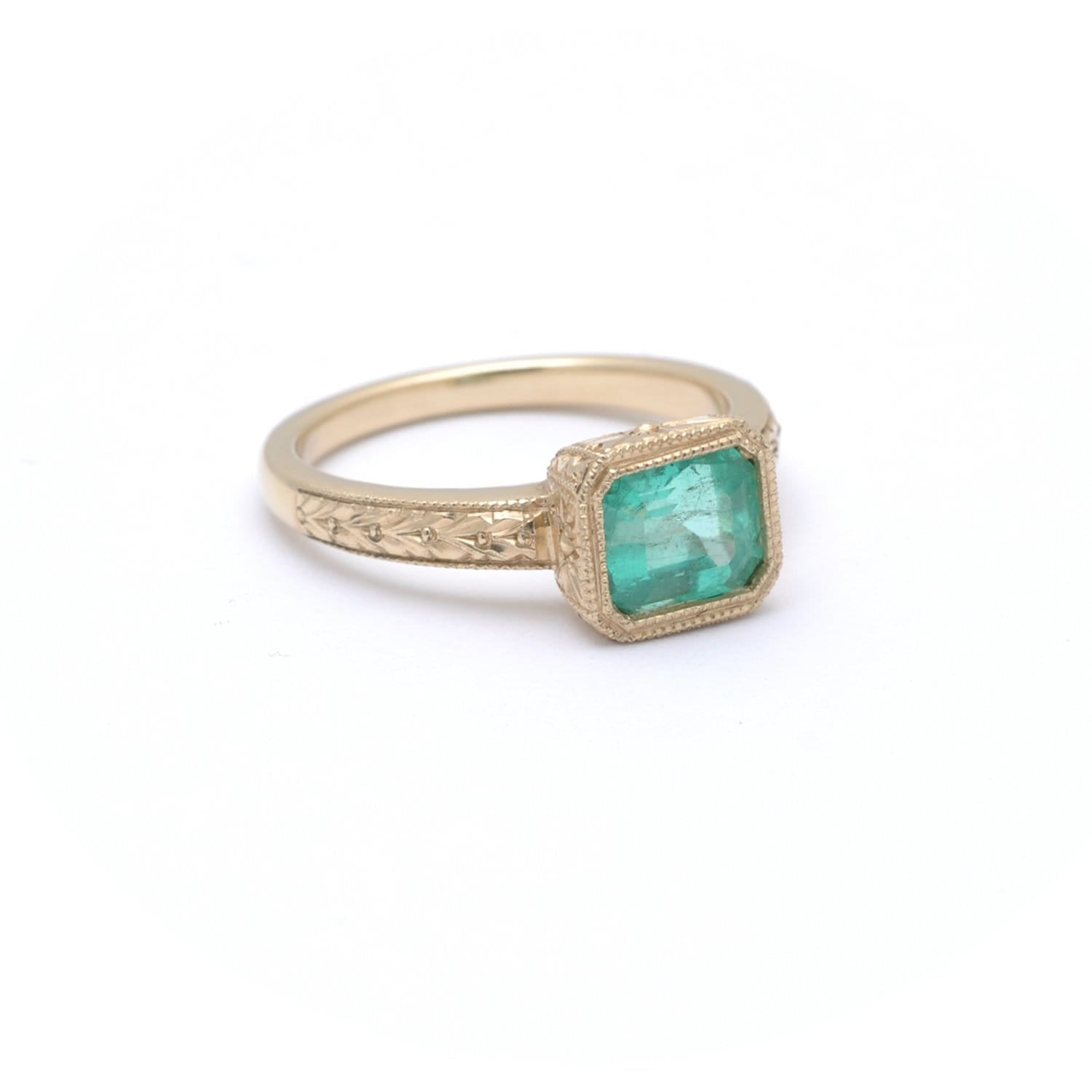 Emerald Yellow Gold East West Ring