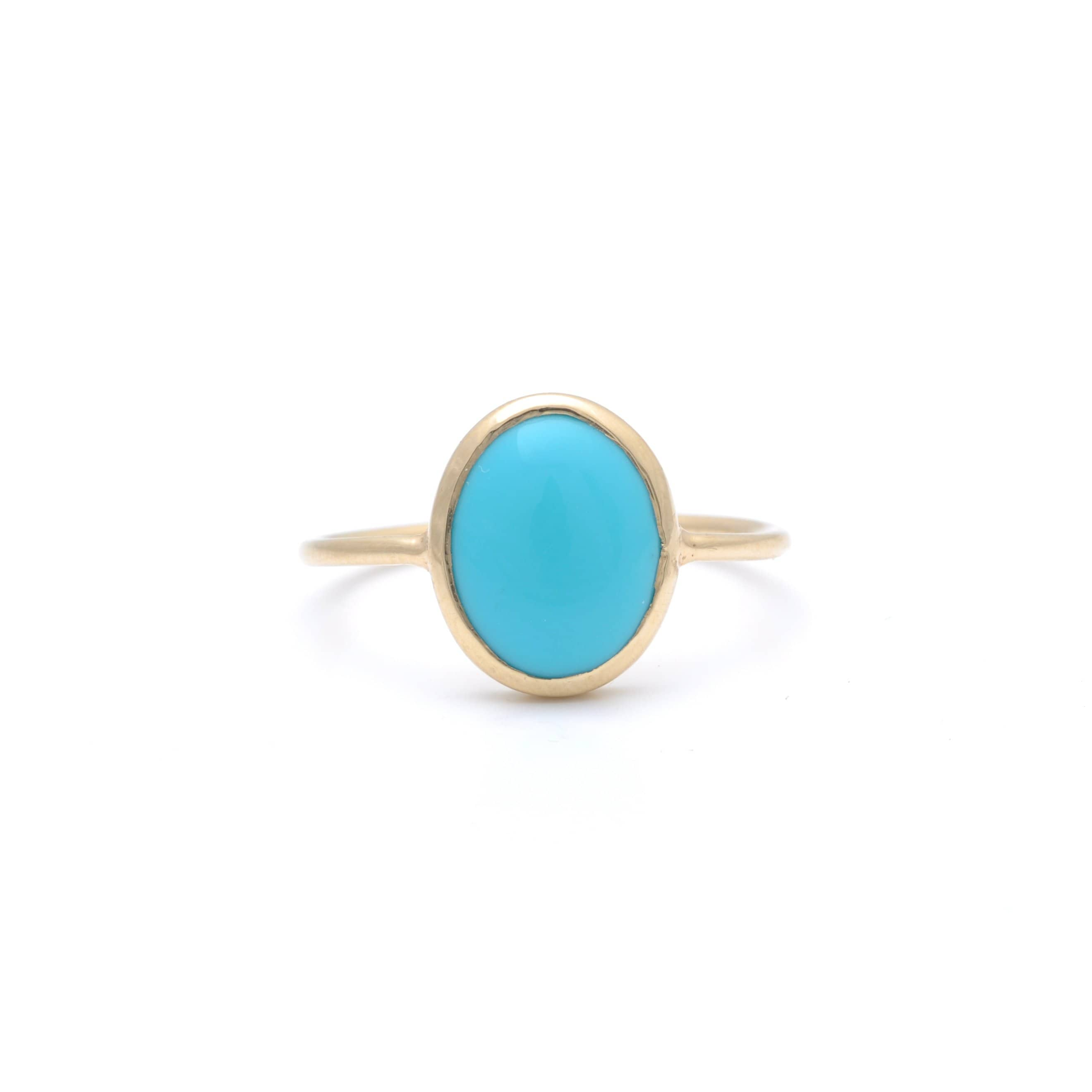 Large oval turquoise ring.