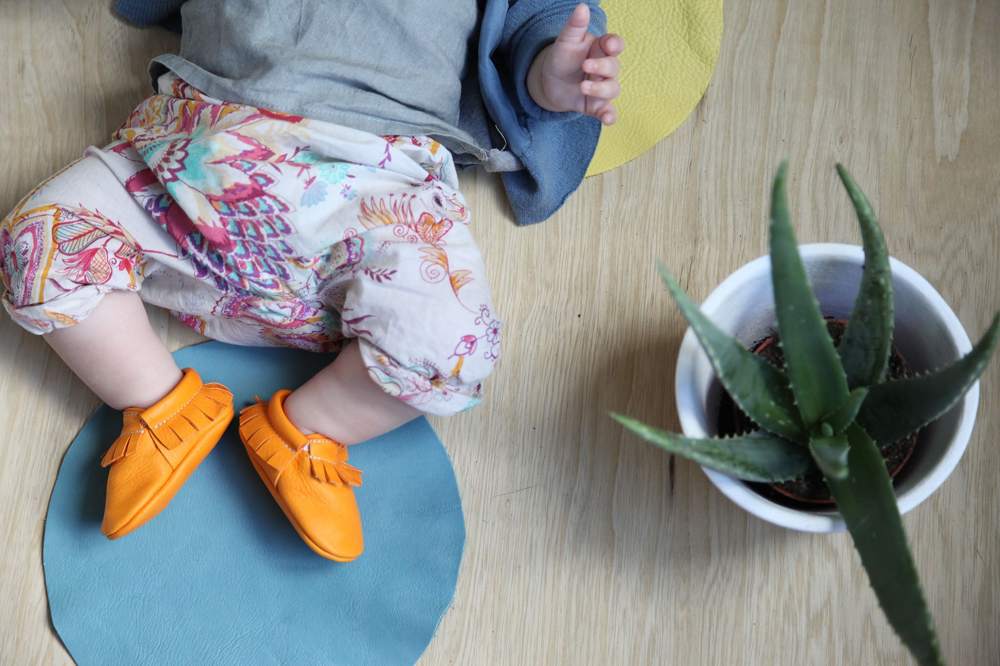 orange baby moccasins from amy and ivor