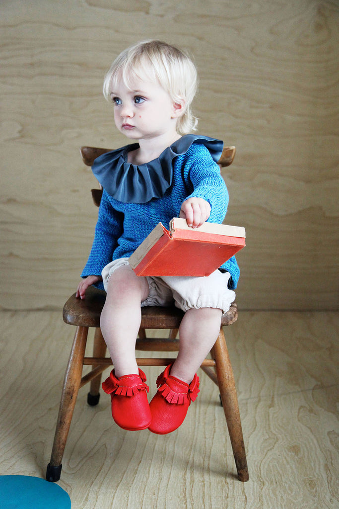 Red baby moccasins from Amy & Ivor
