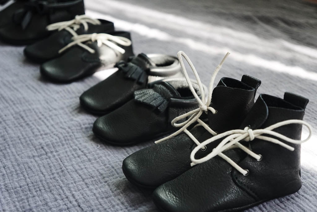 Amy and Ivor black baby moccasins by Charisse Goings growing up goings blog