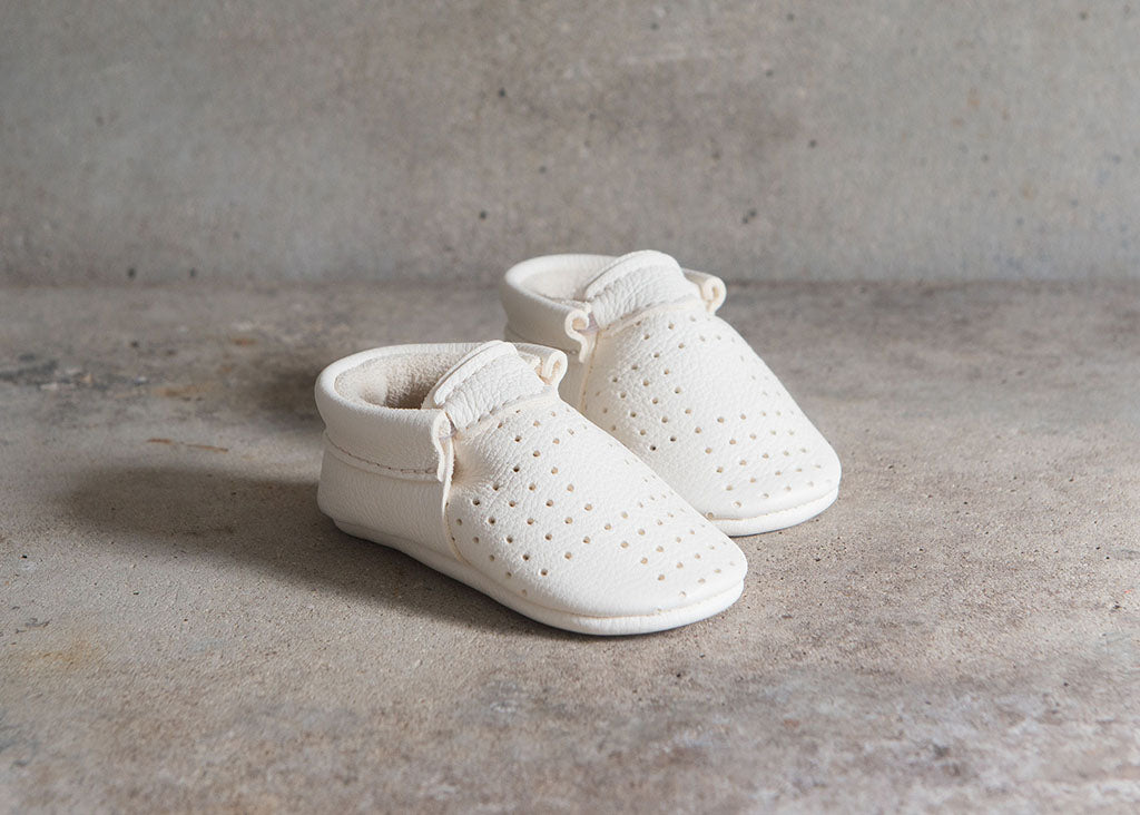 amy and ivor minimalist white perforated moccasins