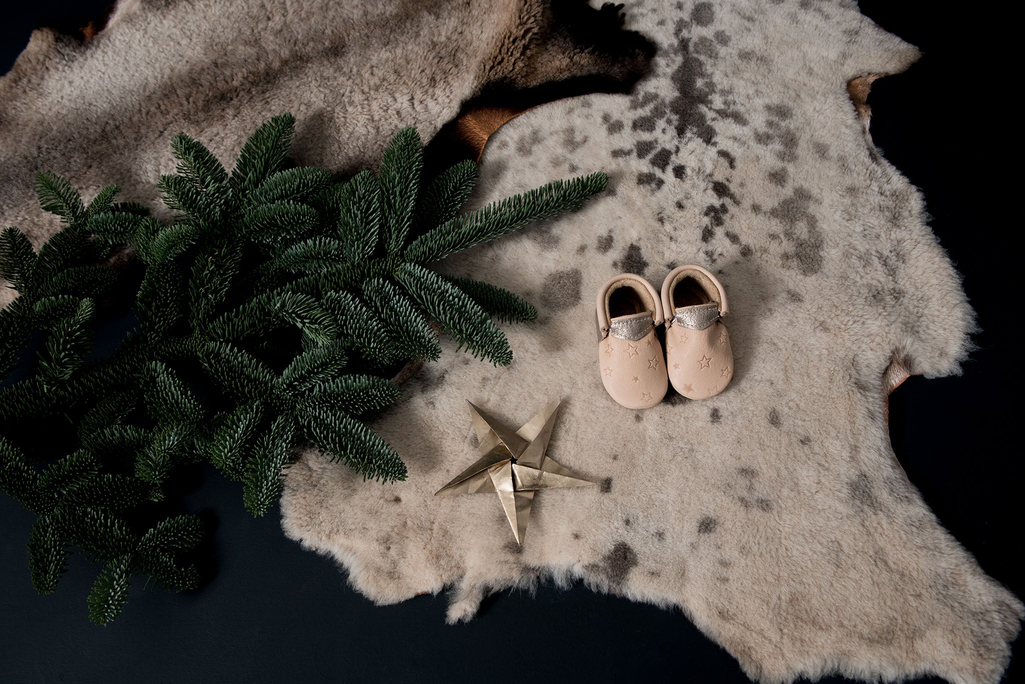 Cute festive start embossed christmas baby shoes. Exclusives handmade eco leather baby shoes by Amy & Ivor for Cissywears at Liberty London.