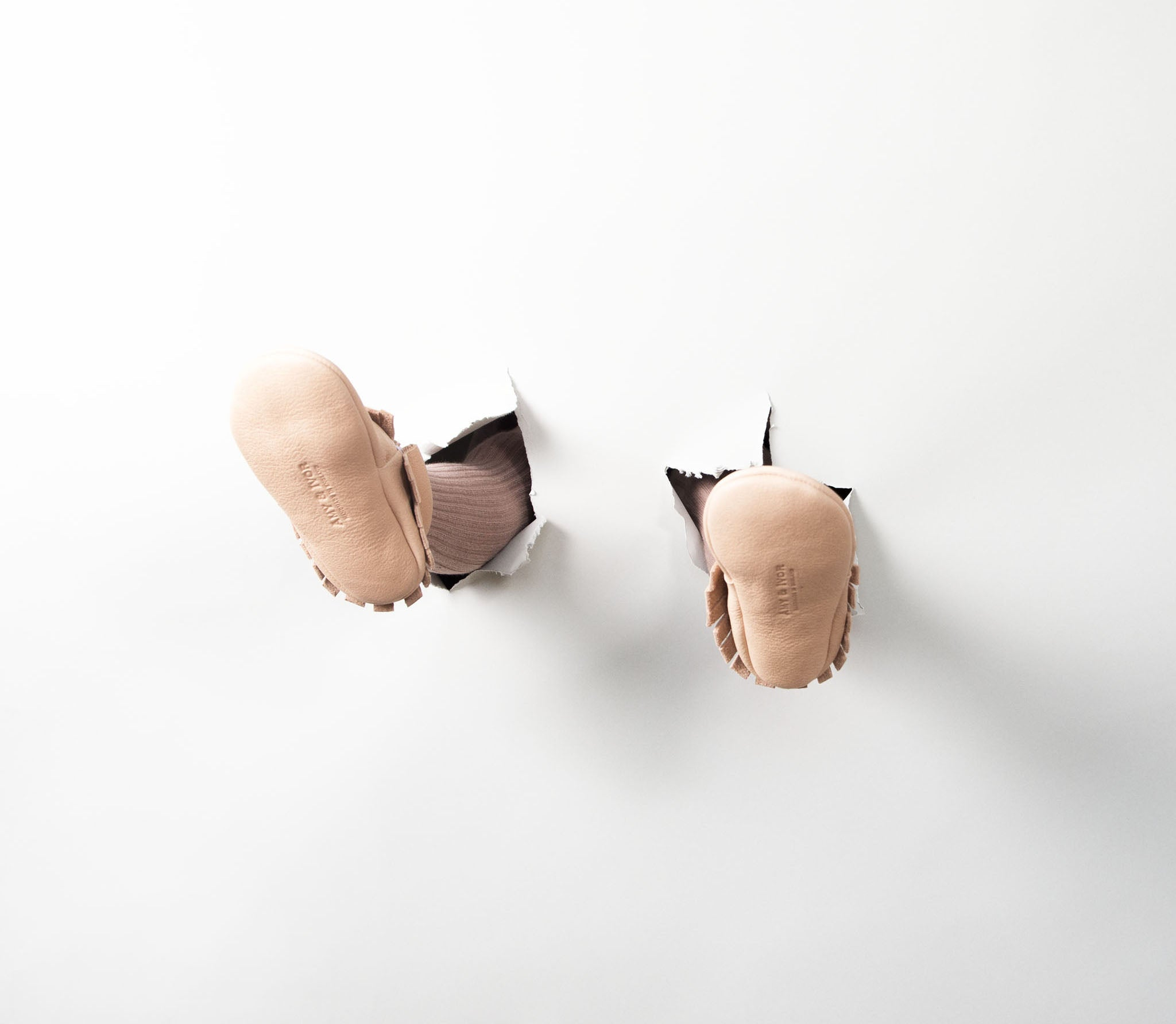 Nude natural leather original baby moccasins by Amy & Ivor. Handmade in England. Photo Alice Hedley Apphia Michael