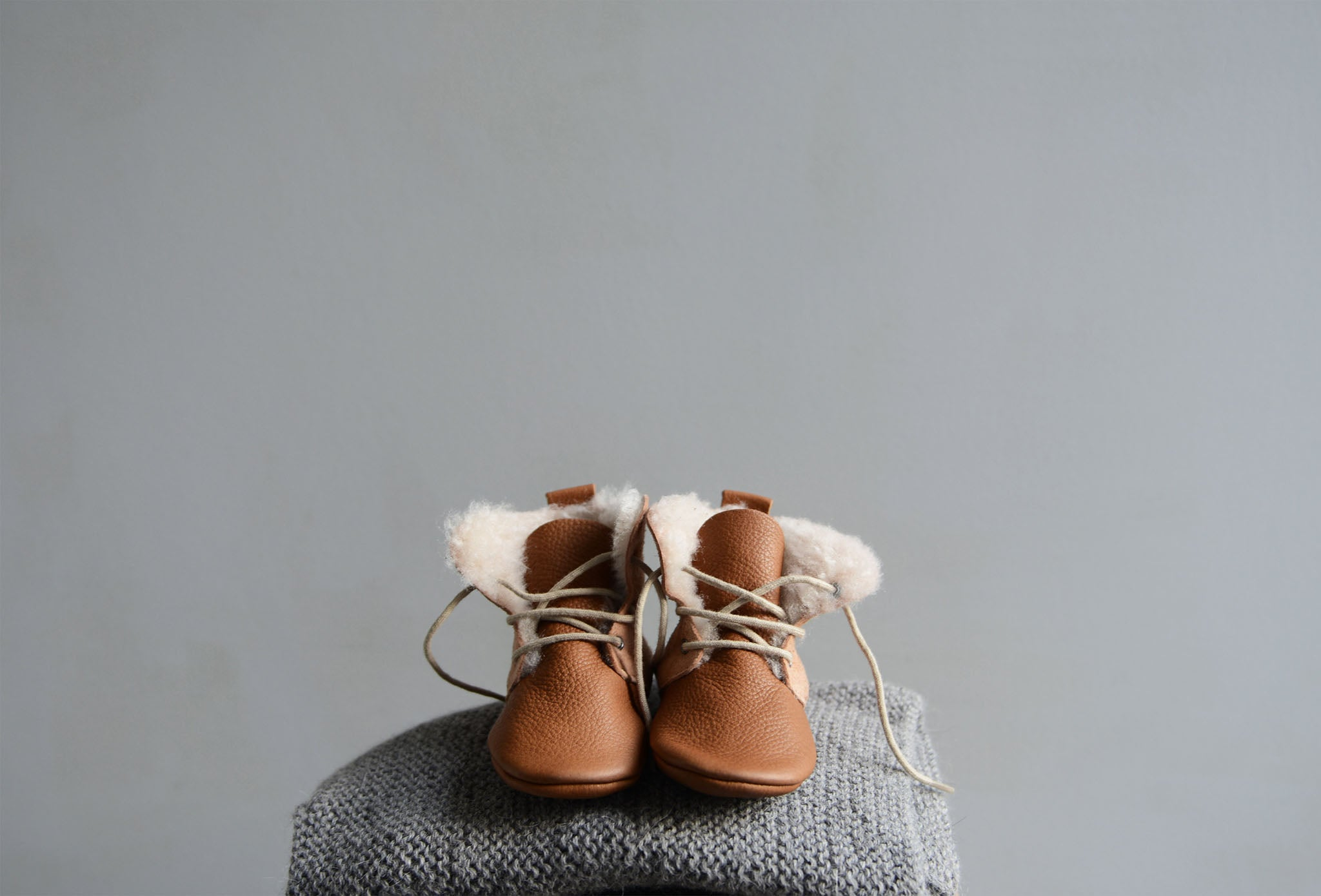 Amy & Ivor tan natural sheepskin baby boots.  Cinnamon high tops by amy and ivor. Chrome free leather