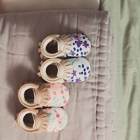 amy and ivor baby moccasins hand painted flowers pink and blue eco and ethically handmade in the uk. Camomile london quilts
