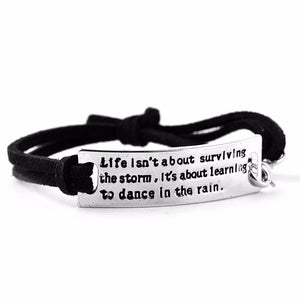 LIFE ISN'T ABOUT SURVIVING THE STORM MOTIVATIONAL BRACELET