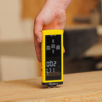 Trotec 510 Moisture Meter inserted into wood