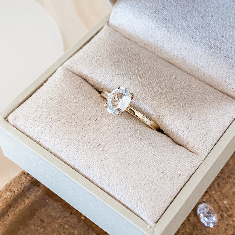 Oval white sapphire engagement ring