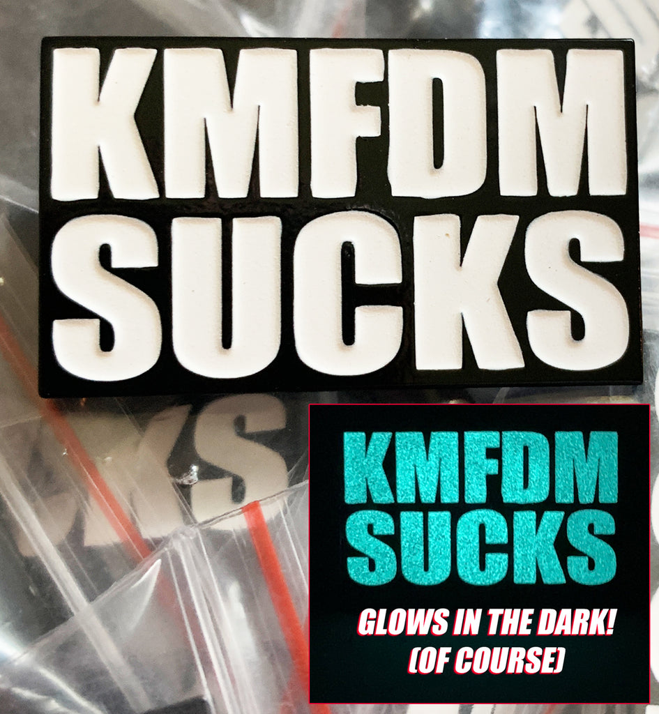 """KMFDM SUCKS"" Glow-In-The-Dark Pin - NEW!!!"