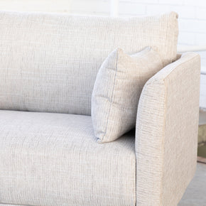 close up of cream 3 seater sofa with pillow