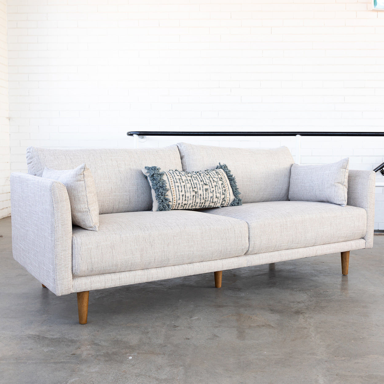 cream 3 seater sofa styled with pillows