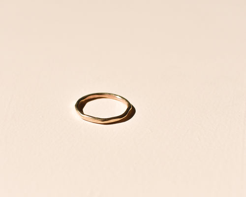 hammered gold ring, fine gold jewellery, gold faceted ring, delicate ring, stacking ring, blush background, handmade