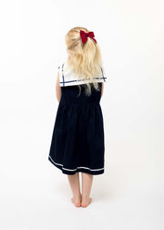 girls navy sailor dress back view