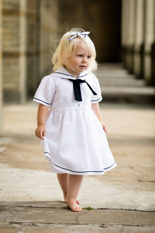 girl in a white linen sailor dress