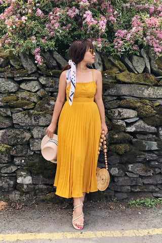 PREORDER: Butterscotch yellow bustier cross-back dress with pleated skirt