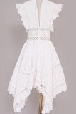 Intricate ruffled eyelet dress with bias hem
