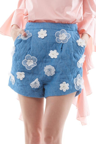 Quilted denim shorts with floral embellishments