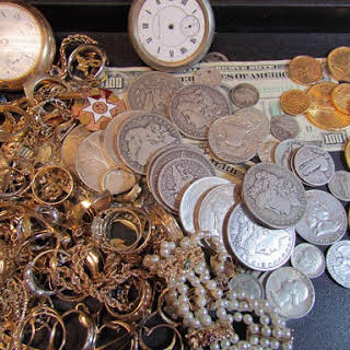 a display of jewelry and coins
