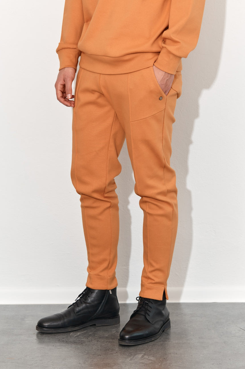 NUGGET ORANGE TROUSERS UNITE
