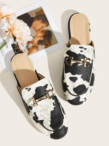 Black and White Cow Print Metal Decor Flat Mules Flats