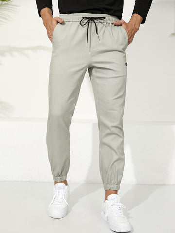 Letter Patched Drawstring Waist Tapered Pants