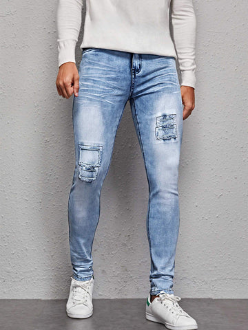 Light Washed Ripped Zipper Fly Tapered Jeans