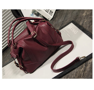 2018 New Women European and American wind soft pure color leather handbag