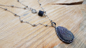 "Large druzy pendant and black lava bead suspended from an ō charm.  Double strand of silver satellite chain, 33"" total length"