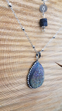 Large druzy pendant and black lava bead suspended from an ō charm.  Double strand of silver satellite chain, 33